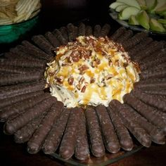 Turtle Cheesecake Dip    2 8oz. pkg. cream cheese softened  1 c. powdered sugar  1 jar of caramel sauce (small jar or about 1 cup)  1 1/2 c. chopped pecans  1 c. grated chocolate or milk chips  1 tsp. vanilla    Beat cream cheese,powdered sugar,vanilla,and 3 tsp. caramel sauce. Roll into a ball or square and roll in pecans. Top with caramel. Refrigerate and serve with apple slices or lady fingers