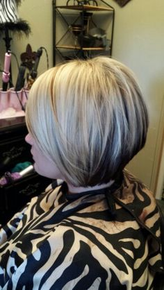 Women's short hair: I'd use my shears and razor to do the diagonal and fringes. The color would be a level 9 with some 5 in it. I'd rebook both for 4-6 weeks. For the finishing look I'd round brush her out. Products: color extend, or all soft line. Root lift, outshine
