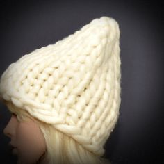 Hand knitted beanie hat made using super soft acrylic yarn. Able to be worn with practically any outfit you desire! This is a thick bulky knit hat that is super trendy and fashionable ! One size fits most. Unisex. Color: Light gray