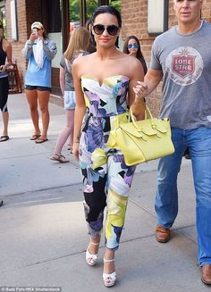 Looking bright: Demi Lovato sported a summery jumpsuit as she was spotted leavingThe Gree...