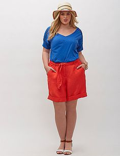 This tee goes way beyond basic with crochet trim on the shoulders and sleeves. Deep V-neck. lanebryant.com