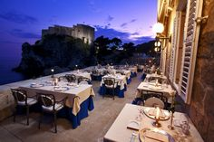 Nautika Restaurant in Dubrovnik, has an imposing setting by the sea at Pile, by the entrance to the Old Town. The outdoor terraces are particularly popular on warm summer evenings, specialties feature locally caught fish. - See more at: http://designlimitededition.com/romantic-restaurants-around-the-world/#sthash.SzfNuwv1.