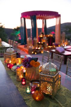 Real Wedding Album: Elshane & Taylor's Moroccan-Themed House Party candle centerpieces I should have stayed with wedding planning Moroccan Party, Moroccan Theme, Indian Party, Moroccan Wedding Theme, Oriental Wedding, Indian Theme Parties, India Theme Party, Indian Wedding Night, Punjabi Wedding Decor