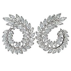 Stunning Marquise Diamond Gold Wreath Style Swirl Earrings. Made identical to the pairs of fabulous earrings worn on the red carpet today, these are the perfect earrings to add to any collection!  12.85 carats of F color VS clarity Marquis cut diamonds set in 18k white gold.