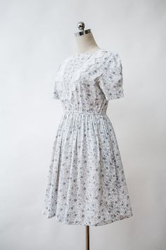 Vintage Floral Dress with doilies detail and high waisted skirt.  Condition: Very Good Vintage. very Pale beige mark along neckline. Color: crema white,