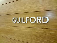 Office reception area wall sign NYC -Satin aluminum reception area wall sign installed in NYC. We specialize in custom wall signs in New York, NY. Visit our website below to contact us for a free consultation! http://www.WallSign.com