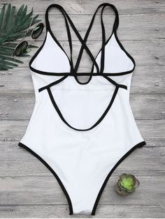 AD : Contrast Piping Strappy High Cut Swimsuit - WHITE With sporty vibes this one piece swimwear features double strap design, contrast piping throughout, low open back and high cut sides that visually elongate your legs, padded. Swimwear Type: One Piece Gender: For Women Material: Nylon,Polyester,Spandex Bra Style: Padded Support Type: Wire Free Collar-line: Spaghetti Straps Pattern Type: Others Waist: High Waisted