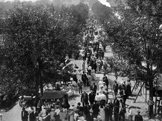 Fairgoers in their finest stroll along the main street at the 1909 Indiana State Fair.  Hats were a fashion requirement during the age as were long flowing dresses and suits.