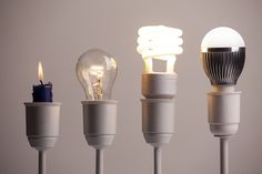 Photo about Evolution and progress of lighting shown with a candle, tungsten, fluorescent and LED bulb. Image of creative, light, save - 84549819