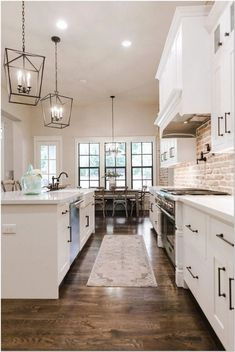 Farmhouse kitchen charm did not simply come about when Fixer Upper debuted. They have been around for a long time- check out these gorgeous farmhouse kitchen cabinet ideas, farmhouse kitchen cabinets, farmhouse style kitchen to get inspired now! Industrial Farmhouse Kitchen, Farmhouse Kitchen Cabinets, Farmhouse Interior, Modern Farmhouse Kitchens, Home Kitchens, Kitchen Modern, Farmhouse Style, Kitchen Backsplash, Farmhouse Flooring