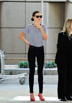 Stripe shirt, skinny black jeans, red pumps, red lipstick, and ray bans....Yes! (My favorite things together!! wut up)