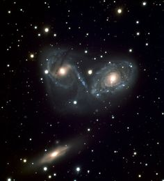 Galaxy Triplet NGC 6769-71 is a gravitational interacting triplet of galaxies, located about 190 million light years away in the southern constellation of Pavo (the Peacock).