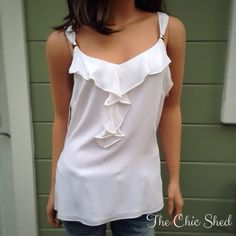 HPWHBM White Silk Ruffled Tank Sweet and feminine. Silver decorative embellishments on straps. Worn once, like new. Side zip. The Chic Shed; A Current and Classic Fashion Curation.  10% OFF BUNDLES I ❤️ THE OFFER BUTTON ❌NO PP, TRADES, HOLDS❌ White House Black Market Tops Tank Tops