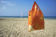 FRUTTI Orange on a beach. If not the beach, get the bag: http://www.loqi.eu/collections/bag-collections/products/frutti-orange