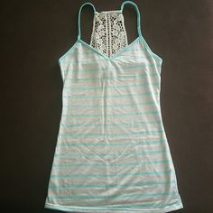 NWOT tank top Never been worn or washed...but somehow there is a small spot on it so not sure what it is. Would probably come out when washed. Rue 21 Tops Tank Tops