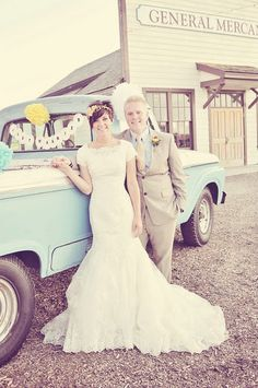 I love this picture! Cute people and a fun old truck full of wedding gifts.