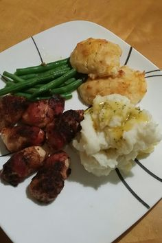 Bacon wrapped Chicken Bites, garlic mashed potatoes, cheddar bay biscuits, green beans
