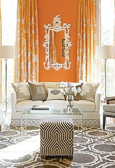 This room is full of neutrals with a bold orange wall in one area of the room. The one orange wall adds some light and life to the room.