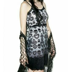 The Curse dress The Curse skull and cross dress by Rat Baby. Super soft and stretchy skull and cross lace print dress with double adjustable straps and scalloped lace hemline. Polyester blend. Size 8. NWT and comes from a smoke free home. Rat Baby Dresses Mini