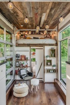 Alpha Tiny House 0023 Garage Door is great Idea. Don't know how it would work in our environment. Would save space on the end of my TH.