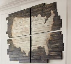 Stain over a stencil.  I've seen this technique done on a solid wood base with even edges, but I like this one.  USA outline, stained onto four panels made with uneven, scrap pieces of trim.  Rustic, country, cabin decor.  Perfect DIY man cave decor.  Pic for inspiration.