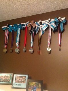 Peg Strips from Lowe's great way to display medal's and bows!