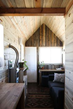 The front of Christopher & Merete's tiny home.  Christopher welcomed the challenge of designing & fabricating his very own home from scratch. They gathered inspiration from blogs such as Tiny House Blog, Tumbleweed Houses, & Tiny Tack House, among others. . . . .   ღTrish W ~ http://www.pinterest.com/trishw/  . . . .