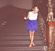 Blue feather skirt and red shoes