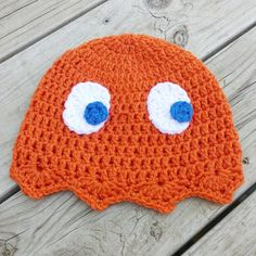 Clyde the orange Pacman Ghost beanie crocheted by hand. One size fits most everyone youth to adult. Hand crocheted with acrylic. I would recommend hand wash and lay flat to dry only. However material