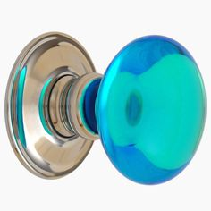 A door knob with an intense blue motif mouth-blown into translucent ...