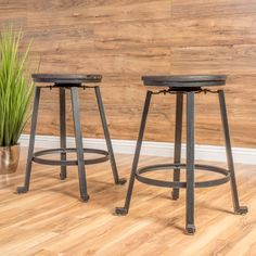 Enjoy these counters stools in your home. Featuring a firwood seat ideally placed on an iron frame, these stools will complement almost any counter or counter height table in your kitchen. The footrest is an added benefit that will help your feet stay comfortable while sitting down. If you're looking for a more rustic looking counter stool then the Navarrete counter stool is the right piece to add to your kitchen.