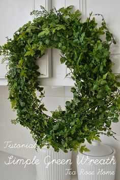 Gorgeous and oh so simple.  I'm not a huge silk flower fan, but this is something I love -- Tea Rose Home: Tutorial~ Simple Green Wreath. #wreath