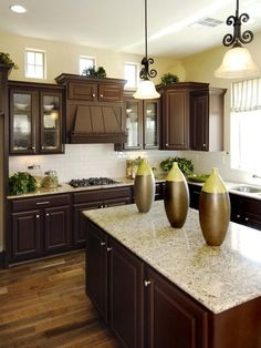Dark cabinets with subway tile back splash