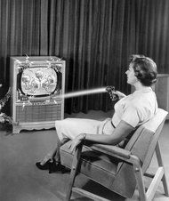 Zenith's Flash-Matic, the first wireless remote, transmitted a light beam to photo cells embedded in a TV, turning the set on or off or changing channels. But the technology was soon obsolete.Lg Electronics/European Pressphoto Agency.  Notice the dancing cocktails and the cool zaps!