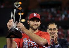 Pitcher Michael Wacha holds up his MVP award as he celebrates the St. Louis Cardinals 9-0 win over the Los Angeles Dodgers of Game 5 of the ...