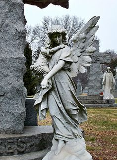 Angel with Child at St. John's Cemetery in New York, NY.