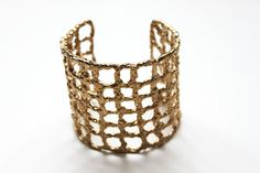 metal crochet cuff (a collaborate art piece by cheryl cambras and tiny armour) $80 from TinyArmour on Etsy