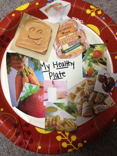 Teaching healthy eating. Students use grocery flyers, cutting out nutritious foods from the food groups.