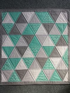 Triangle bliss, change mat, pram or bassinet quilt in Grey's and mint green www.facebook.com/KATNAPquilts