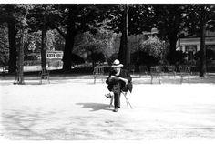 Man reading in a park  Paris 1954  Robert Frank
