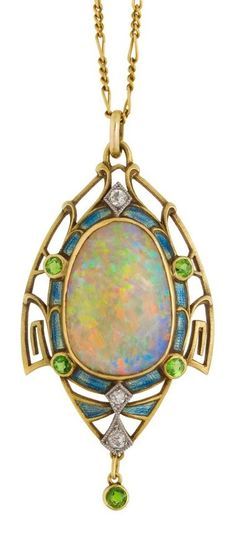 An Art Nouveau opal pendant framed in gold set with diamonds, enamel and demantoid garnets.