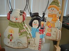 These hand painted ornaments have ink stamped backgrounds