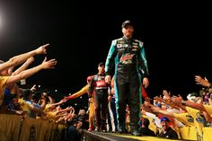 Dale Earnhardt Jr. Photos Photos - Dale Earnhardt Jr., driver of the #88 Mountain Dew Baja Blast Chevrolet, is introduced prior to the NASCAR Sprint Cup Series Sprint All-Star Race at Charlotte Motor Speedway on May 16, 2015 in Charlotte, North Carolina. - NASCAR Sprint All-Star Race