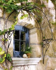 English Overdoor Trellis at Horchow. I have two ornate basket wedding arches that are too bent up to stand.will post a pic as soon I redo them into this amazing over the door/window trellis? Outdoor Wall Art, Outdoor Walls, Outdoor Spaces, Outdoor Living, Outdoor Decor, Indoor Outdoor, Iron Trellis, Wall Trellis, Vine Trellis