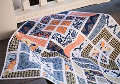 Welcome couture décor. This chateau-inspired collection of elegant lifestyle fabrics brings a fantastic flavor of French florals, crisp geometrics and an ethnic Ikat into harmony. The Botanique Quilt combines these vibrant fabrics as fresh interpretation for your couture decor.