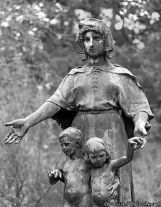 A Statue that Moves   Photo by Chris Stewart Taken before repairs where done. Another phenomenon connected to this haunting is a statue called, Pioneer Women and Children. This statue is near the lake and the old log cabin that houses the California Women's Pioneer Association.  When the ghost is active at the lake witnesses report this statue moves as well. Another trigger is when people stand near it late at night. The statue then comes to life and changes positions. Its' face changes ...