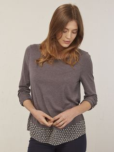 This lovely, casual jersey T-shirt is finished with a pretty printed woven hem, and matching neckline binding and sleeve tabs. You can wear the sleeves long or at three-quarter-length while the curved hemline and relaxed fit is flattering with jeans.