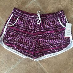 """under armour shorts New with tags. Great pattern. Soft. Tie at waist, stretchy at waist. ❌No trades or PayPal❌ Quick shipping offers welcome through """"Make an Offer"""" feature. Bundle discount on 2+ items using new bundle feature. Under Armour Shorts"""