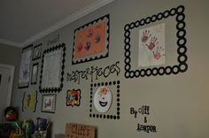 cute frames done with vinyl and cricut and hung on the wall.