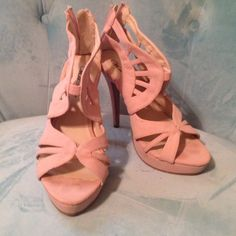 Nude Heels Elegant and pretty nude heels.  Features peep toe and laser cut patterns. Heel is 5 inches with one inch platform. Size 9 Wild Rose Shoes Heels